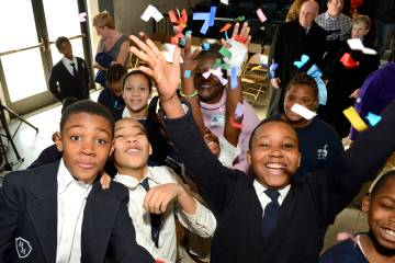 Students celebrate the formal opening of the $43 million Henderson-Hopkins K-8 community school in East Baltimore in February 2014